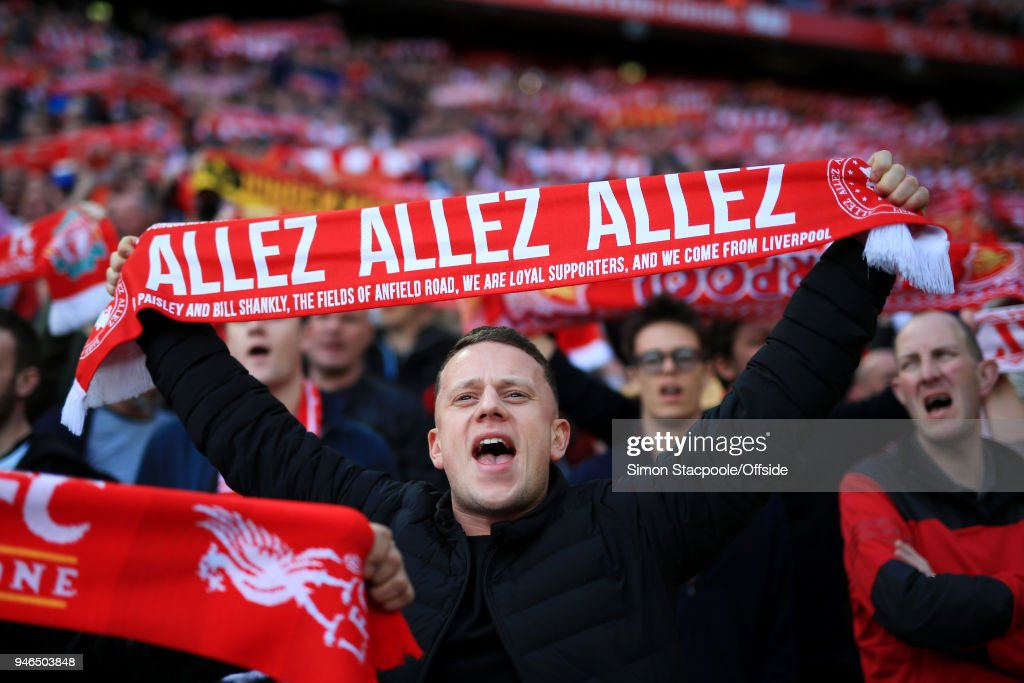 A Liverpool fan holds his 'Allez Allez Allez' scarf aloft as he cheers his team on during the Premier League match between Liverpool and AFC Bournemouth at Anfield on April 14, 2018 in Liverpool, England.