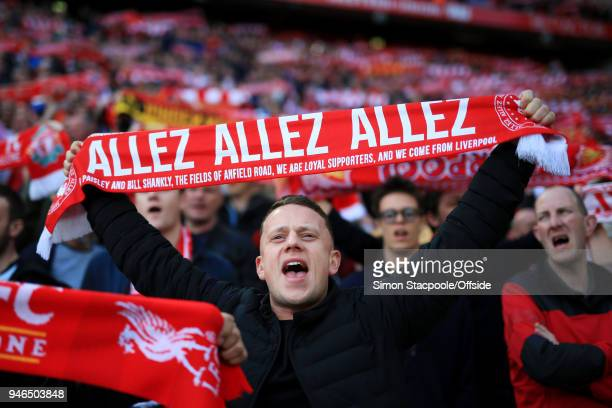 Liverpool fan holds his 'Allez Allez Allez' scarf aloft as he cheers his team on during the Premier League match between Liverpool and AFC...