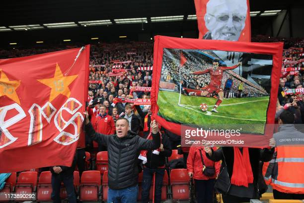 Liverpool fan holds up a banner depicting the famous corner delivered by Trent AlexanderArnold of Liverpool during their 2019 UEFA Champions League...