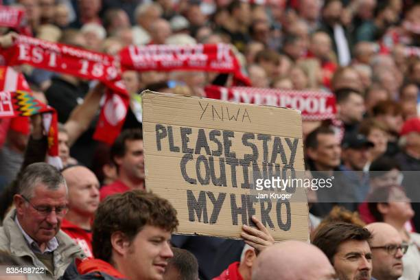 Liverpool fan holds up a sign during the Premier League match between Liverpool and Crystal Palace at Anfield on August 19 2017 in Liverpool England