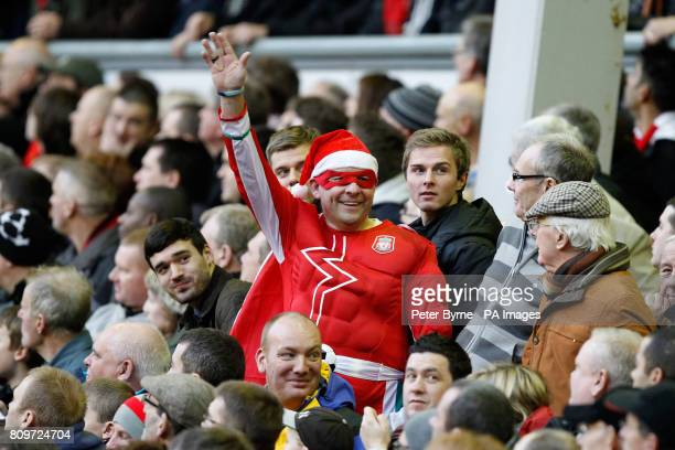 A Liverpool fan in fancy dress on boxing day in the stands