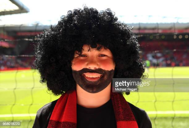 Liverpool fan is dressed as Mo Salah prior to the Premier League match between Liverpool and Brighton and Hove Albion at Anfield on May 13 2018 in...