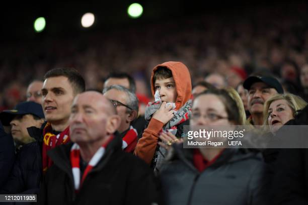 Liverpool fan on the Kop looks on during the UEFA Champions League round of 16 second leg match between Liverpool FC and Atletico Madrid at Anfield...