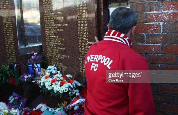 Liverpool fan pays his respects to those who died in the Hillsborough disaster prior to the Barclays Premier League match obetween Liverpool and...