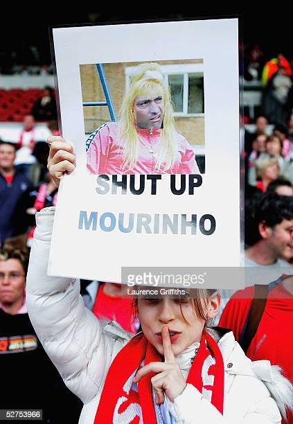 Liverpool fan shows a sign of Jose Mourinho before the UEFA Champions League semifinal second leg match between Liverpool and Chelsea at Anfield on...