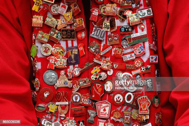 Liverpool fan showscase his badges prior to the Premier League match between Tottenham Hotspur and Liverpool at Wembley Stadium on October 22 2017 in...