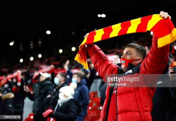 Liverpool fan sings in their socially-distanced seat during the Premier League match between Liverpool and West Bromwich Albion at Anfield on...