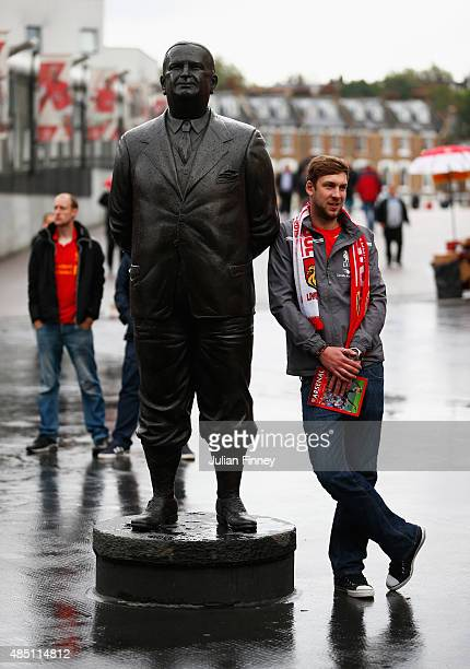 Liverpool fan stands by a statue of former Arsenal manager Herbert Chapman prior to the Barclays Premier League match between Arsenal and Liverpool...