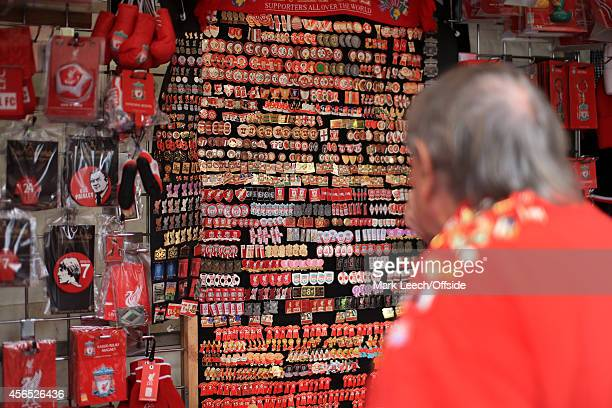 Liverpool fan surveys a huge array of pins and badges prior to the Barclays Premier League match between Liverpool and Everton at Anfield on...