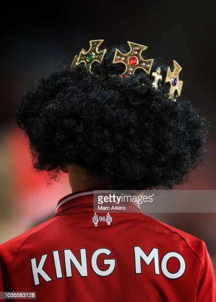 Liverpool fan wears a crown in tribute to Mohamed Salah of Liverpool during the Group C match of the UEFA Champions League between Liverpool and...
