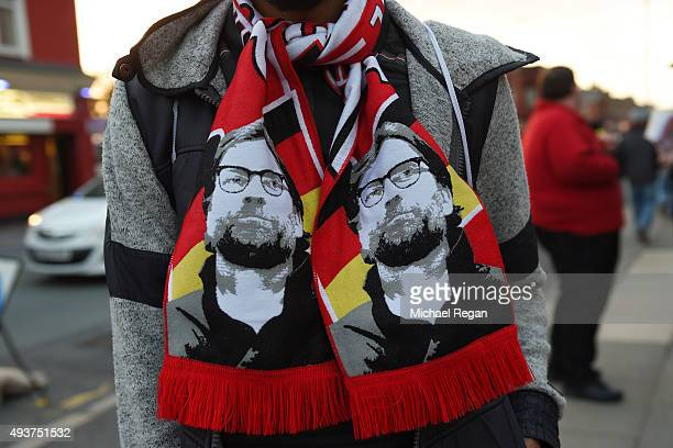 Liverpool fan wears a scarf bearing the likeness of Jurgen Klopp the manager of Liverpool prior to kickoff during the UEFA Europa League Group B...