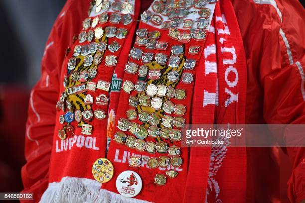 A Liverpool fan wears a scarf covered in badges during the UEFA Champions League Group E football match between Liverpool and Sevilla at Anfield in...