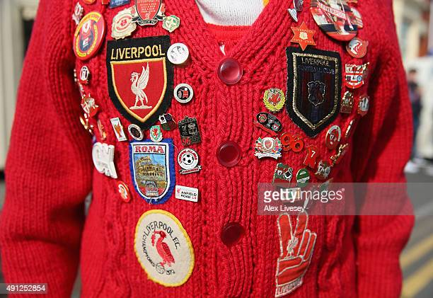 Liverpool fan wears pins and badges prior to the Barclays Premier League match between Everton and Liverpool at Goodison Park on October 4 2015 in...
