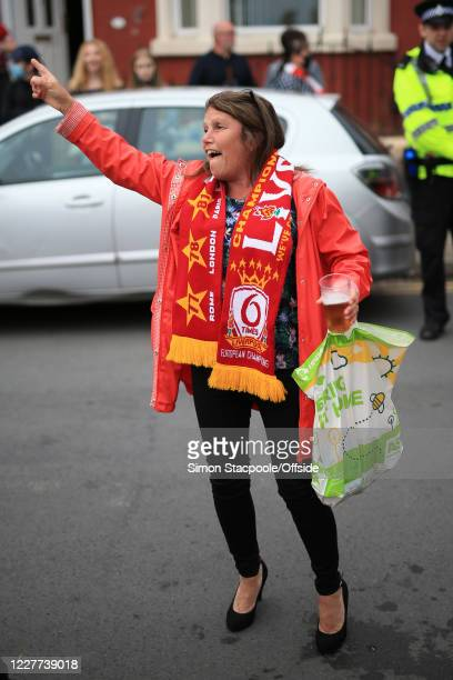 Liverpool fan with a pint and a plastic shopping bag at Anfield on July 22 2020 in Liverpool England