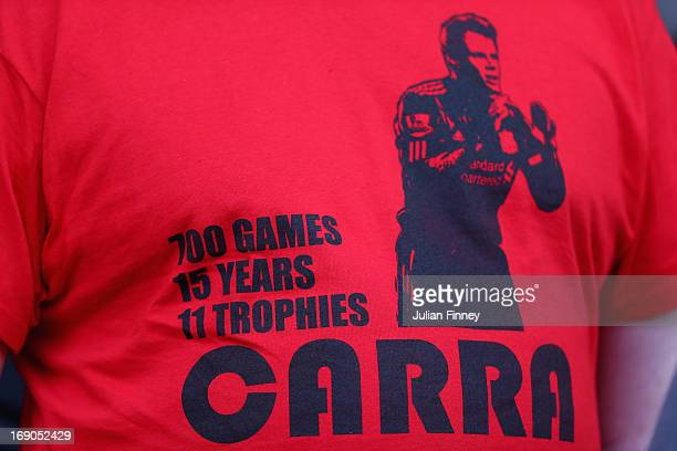 Liverpool fans acknowledge Jamie Carragher of Liverpool's final match for the club prior to the Barclays Premier League match between Liverpool and...