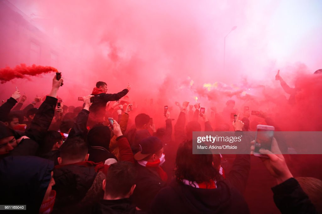 Liverpool fans among flares and smoke bombs as they await the team arrivals during the UEFA Champions League Semi Final First Leg match between Liverpool and A.S. Roma at Anfield on April 24, 2018 in Liverpool, United Kingdom.
