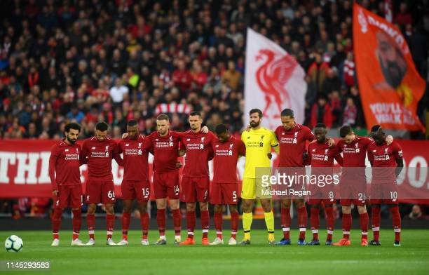 Liverpool fans and players remember former captain Tommy Smith prior to the Premier League match between Liverpool FC and Huddersfield Town at...