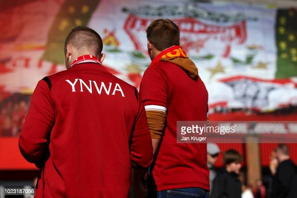 Liverpool fans are seen outside the stadium prior to the Premier League match between Liverpool FC and Brighton Hove Albion at Anfield on August 25...