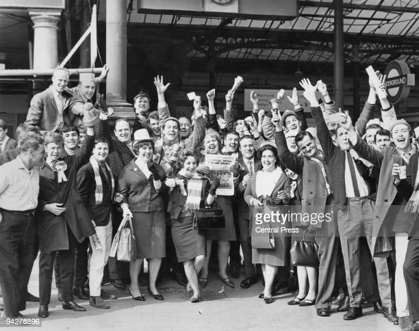 Liverpool fans at Euston Station London 1st May 1965 They are on their way to see their team play Leeds United in the FA Cup final at Wembley A woman...