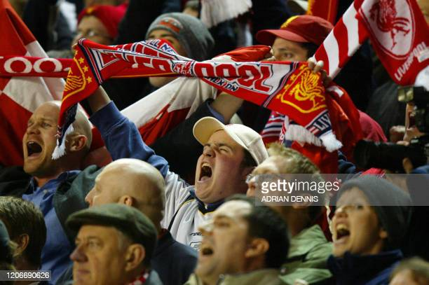 Liverpool fans celebrate after Emile Heskey scored their second goal against AS Roma's in the UEFA Champions League Group B match at Anfield in...