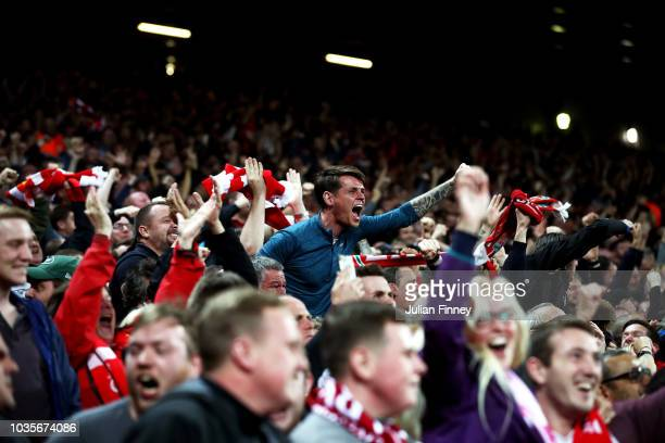 Liverpool fans celebrate during the Group C match of the UEFA Champions League between Liverpool and Paris SaintGermain at Anfield on September 18...