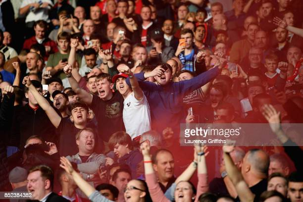 Liverpool fans celebrate during the Premier League match between Leicester City and Liverpool at The King Power Stadium on September 23 2017 in...