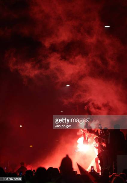 Liverpool fans celebrate outside The Kop stand at Anfield stadium during the Premier League match between Liverpool and Chelsea on July 22 2020 in...