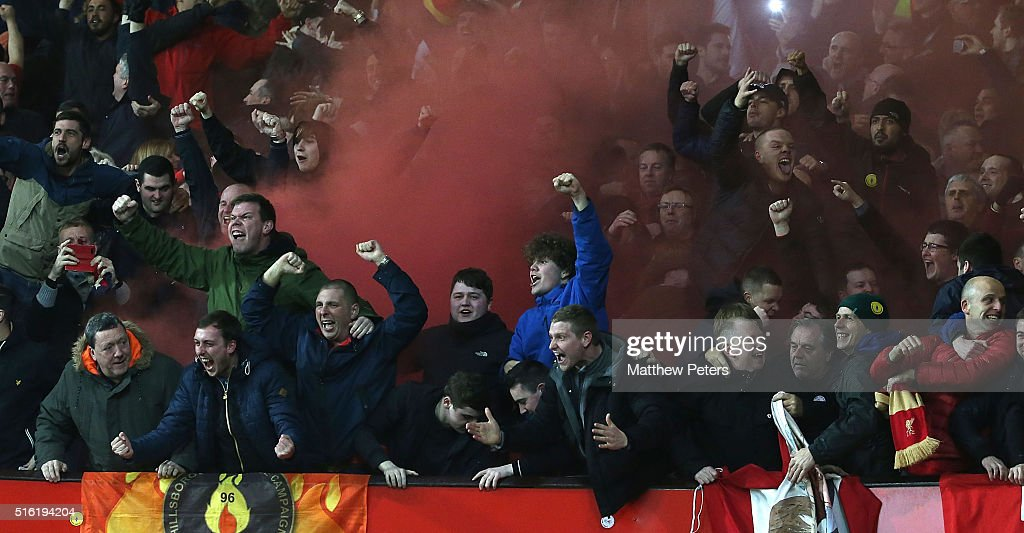 Liverpool fans celebrate Philippe Coutinho scoring their first goal during the UEFA Europa League Round of 16 Second Leg match between Manchester United and Liverpool at Old Trafford on March 17, 2016 in Manchester, United Kingdom.