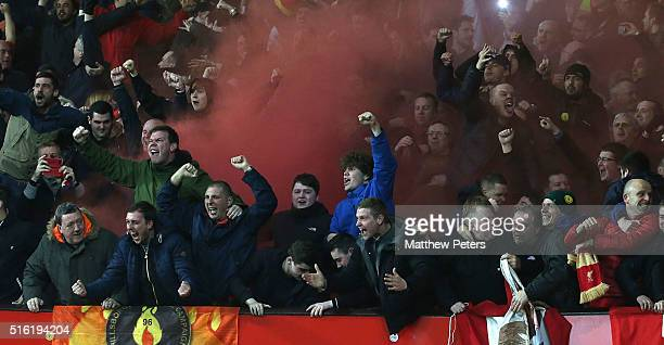 Liverpool fans celebrate Philippe Coutinho scoring their first goal during the UEFA Europa League Round of 16 Second Leg match between Manchester...
