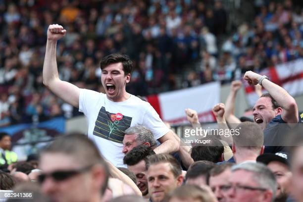 Liverpool fans celebrate their sides first goal during the Premier League match between West Ham United and Liverpool at London Stadium on May 14...
