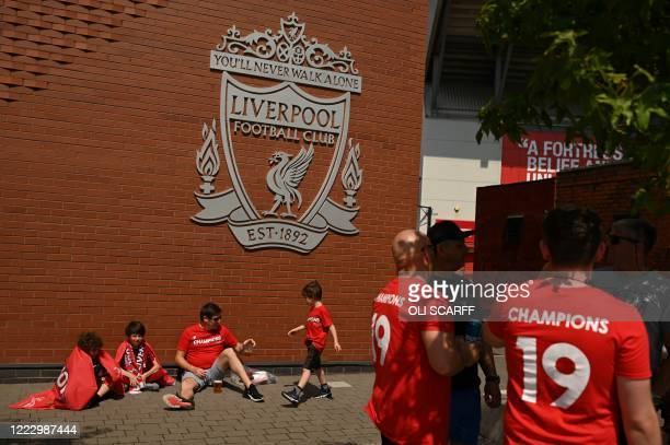 Liverpool fans celebrate victory outside Anfield stadium in Liverpool, north west England on June 26, 2020 after Liverpool FC sealed the Premier...