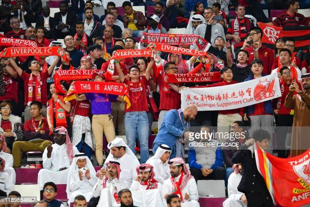 Liverpool fans cheer ahead of the 2019 FIFA Club World Cup Final football match between England's Liverpool and Brazil's Flamengo at the Khalifa...