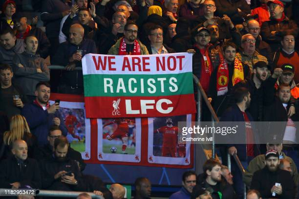 Liverpool fans display a banner in the crowd prior to the UEFA Champions League group E match between KRC Genk and Liverpool FC at Luminus Arena on...