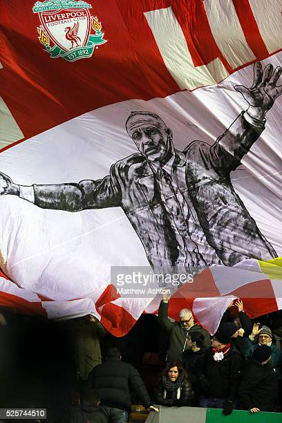 Liverpool fans display a flag of former manager Bill Shankly on The Kop