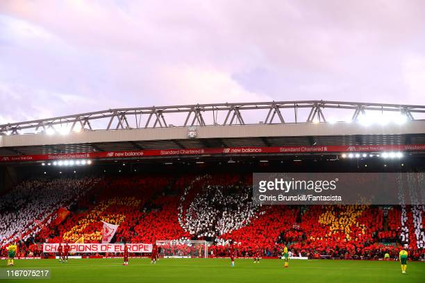 Liverpool fans display a giant mosaic on The Kop during the Premier League match between Liverpool FC and Norwich City at Anfield on August 09, 2019...