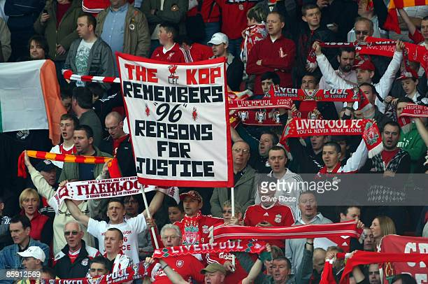 Liverpool fans display banners in reference to the Hillsborough disaster during the Barclays Premier League match between Liverpool and Blackburn at...