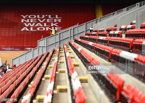 Liverpool fans dress the Kop stand with flags and banners ahead of the Premier League match between Liverpool and Crystal Palace at Anfield on June...