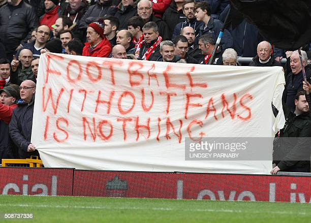 Liverpool fans hold a banner as they protest against the recently announced rise in ticket prices during the English Premier League football match...