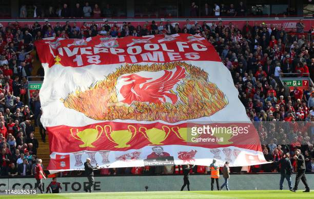 Liverpool fans hold a banner prior to the Premier League match between Liverpool FC and Wolverhampton Wanderers at Anfield on May 12 2019 in...