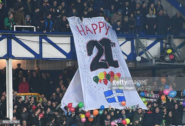 Liverpool fans hold a banner reading 'Happy 21st' mocking the lack of trophies won by their opponents prior to the Premier League match between...