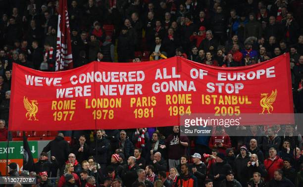 Liverpool fans hold a European Cup trophies banner prior to the UEFA Champions League Round of 16 First Leg match between Liverpool and FC Bayern...