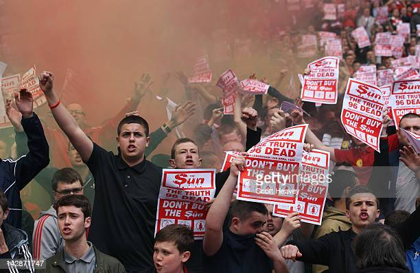 Liverpool fans hold banners in protest against the Sun newspaper prior to the FA Cup with Budweiser Semi Final match between Liverpool and Everton at...