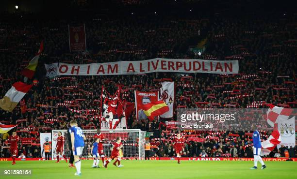 Liverpool fans hold banners scarves and flags on the Kop prior to the Emirates FA Cup Third Round match between Liverpool and Everton at Anfield on...