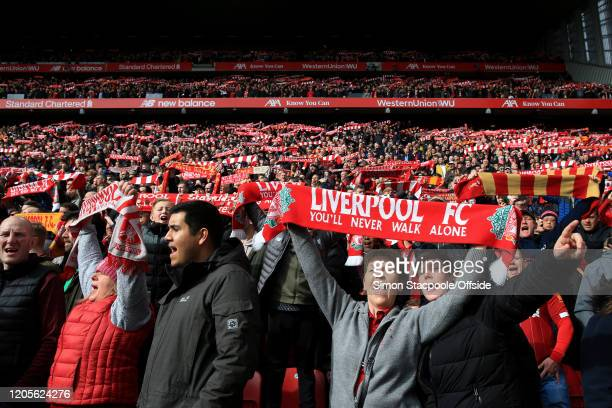 Liverpool fans hold their scarves aloft as they sing 'You'll Never Walk Alone' before the Premier League match between Liverpool FC and AFC...