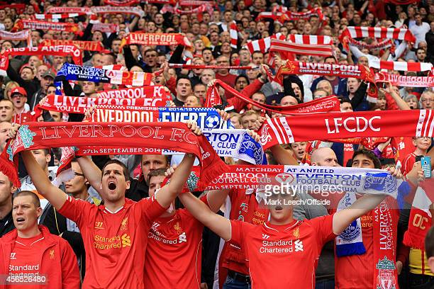 Liverpool fans hold their scarves aloft as they sing 'You'll Never Walk Alone' before the Barclays Premier League match between Liverpool and Everton...