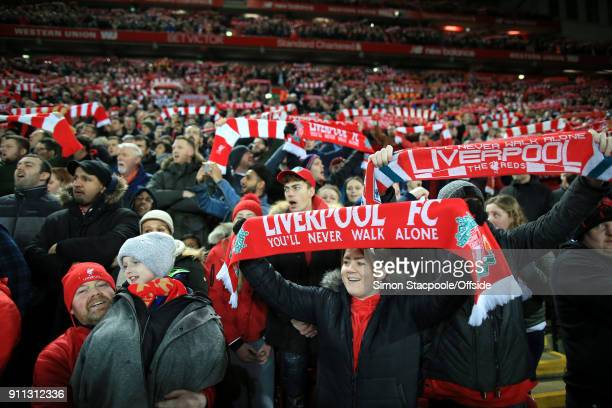 Liverpool fans hold their scarves aloft as they sing 'You'll Never Walk Alone' before The Emirates FA Cup Fourth Round match between Liverpool and...
