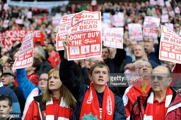Liverpool fans hold up antiSun newspaper sheets before the FA Cup Semi Final match between Liverpool and Everton at Wembley Stadium on April 14 2012...