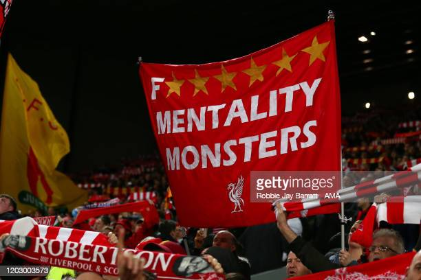 Liverpool fans hold up banners and flags on The Kop during the Premier League match between Liverpool FC and West Ham United at Anfield on February...