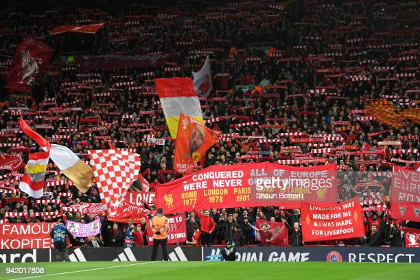 Liverpool fans hold up banners and scarfs prior to the UEFA Champions League Quarter Final Leg One match between Liverpool and Manchester City at...