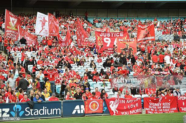 Liverpool fans hold up banners before the start of Liverpool Legends exhibition football game against Australian Legends at the ANZ Stadium in Sydney...